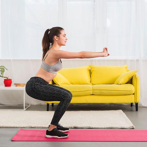 girl-making-squat-in-her-house.jpg