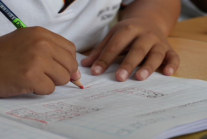 boy writing school.png