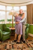 two older people dancing