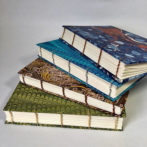 My very first coptic stitch journals. Ea