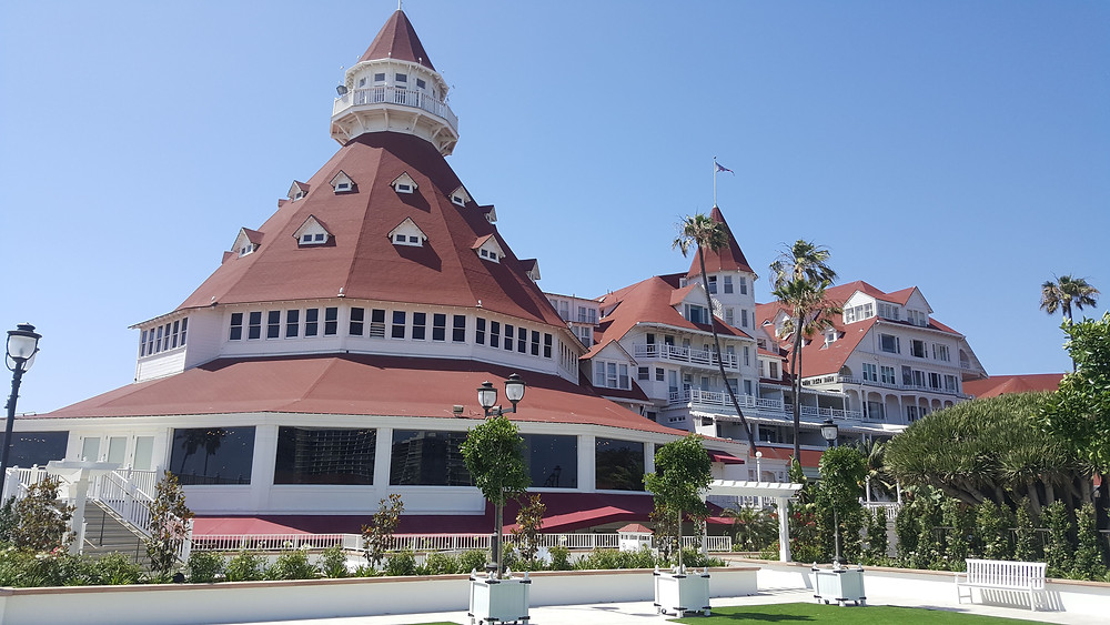The historic Hotel del Coronado with its turrets and red-tiled roofs.
