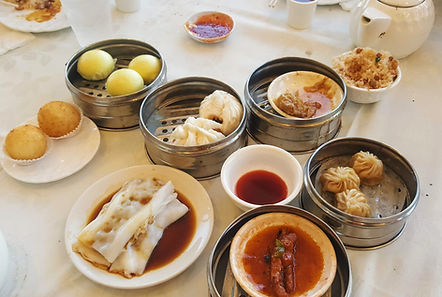 Traditional Cantonese dim sum in steamer baskets.