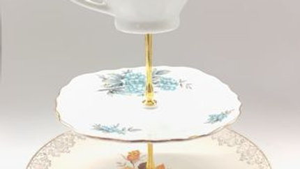 large tea stand summertime with milk jug feature.