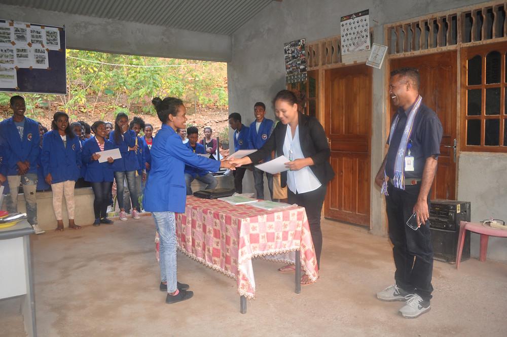 RAEBIA Timor-Leste representatives Sonia Santos (centre) and Xisto Martins (right) congratulate a graduating student