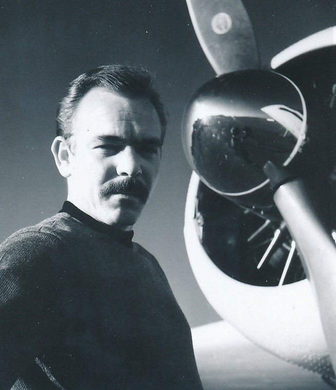 Bill next to airplane.JPG