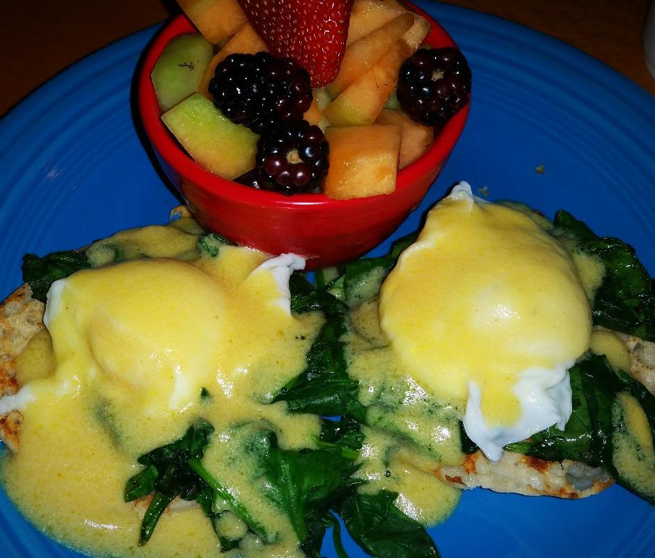 Eggs Florentine and fruit bowl