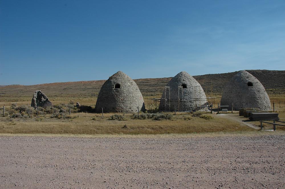 Three beehive-shaped charcoal kilns on the Wyoming plains. Piedmont charcoal kilns in Wyoming.