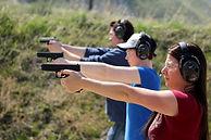 Class of women shooting handgun