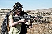 Women shooting AR 15 at class