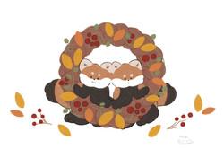 レッサーパンダと秋のリース