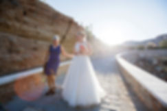 Walking down the aisle on a sunny day.