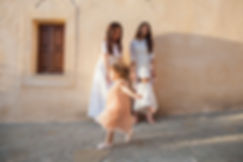 Family moments. Trying for a photograph with two ladies and two kids.Photography Ioanna Chatzidiakou.