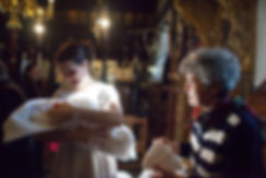 Greek baptism in orthodox Church. Mother is holding her child. Ioanna Chatzidiakou Photographer.