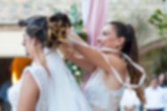 Best woman is changing the wedding wreath in a Greek orthodox wedding.