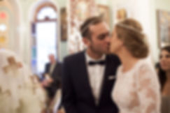 A warm kiss from the groom to the bride during the ceremony.