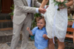 A young boy was tangled up in bride's wedding dress