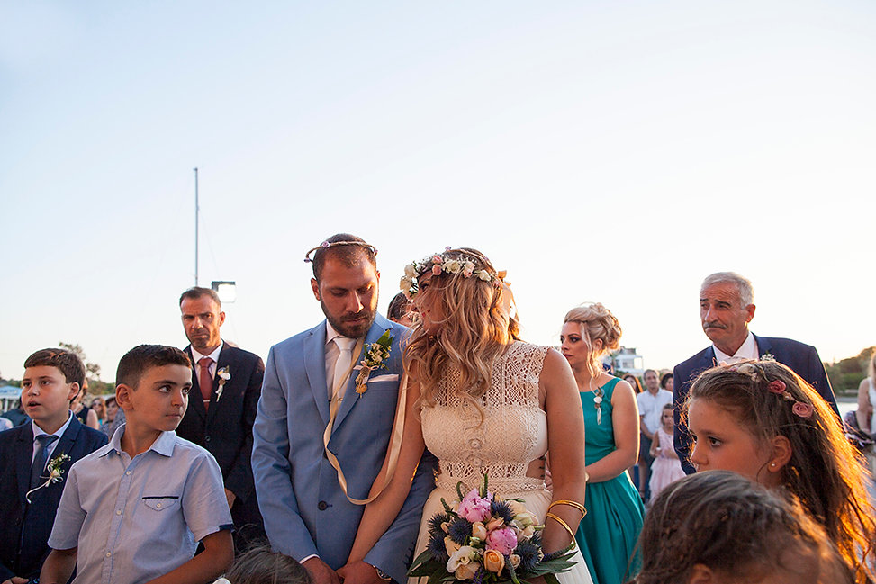 Greek Orthodox wedding, the bride is looking at the groom. Wedding Photography Ioanna Chatzidiakou.
