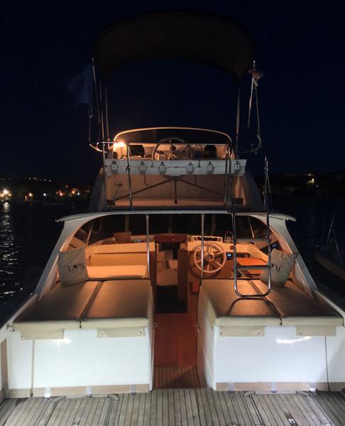 Bertram-31-cockpit-illuminated-at-night.