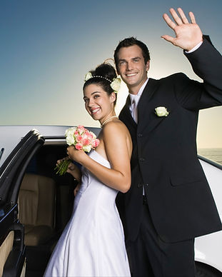 Bride and groom entering a limo