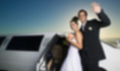Happy couple near limousine at night ready for honeymoon