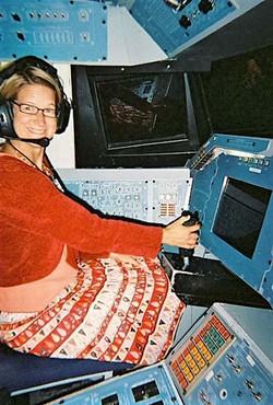 Liz the astronaut inside a rocket (2)