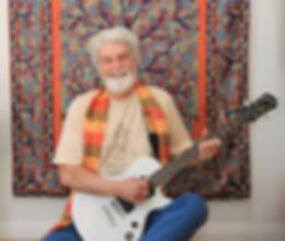 Sajhu with guitar.png