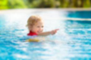 bigstock-Child-In-Swimming-Pool-Summer-2