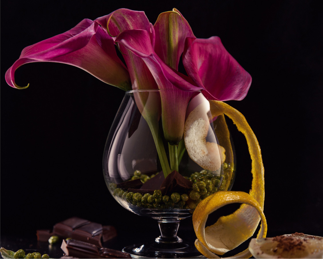 Opulent faux Calla Lily Flower stems in Cognac glass