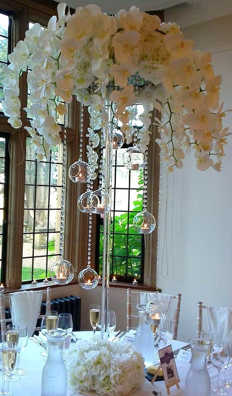 Cascading orchid tall centerpiece