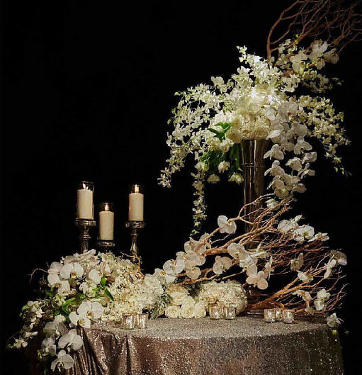 Gorgeous wedding guest signing table florals