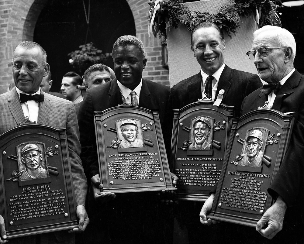 Jackie Robinson was inducted alongside three other baseball greats that year: Edd Roush, Bob Feller, and Bill McKechnie