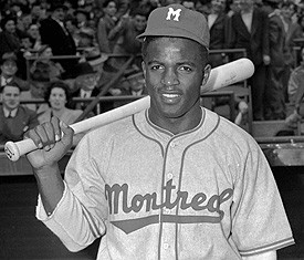Jackie Robinson signs a Major League Contract