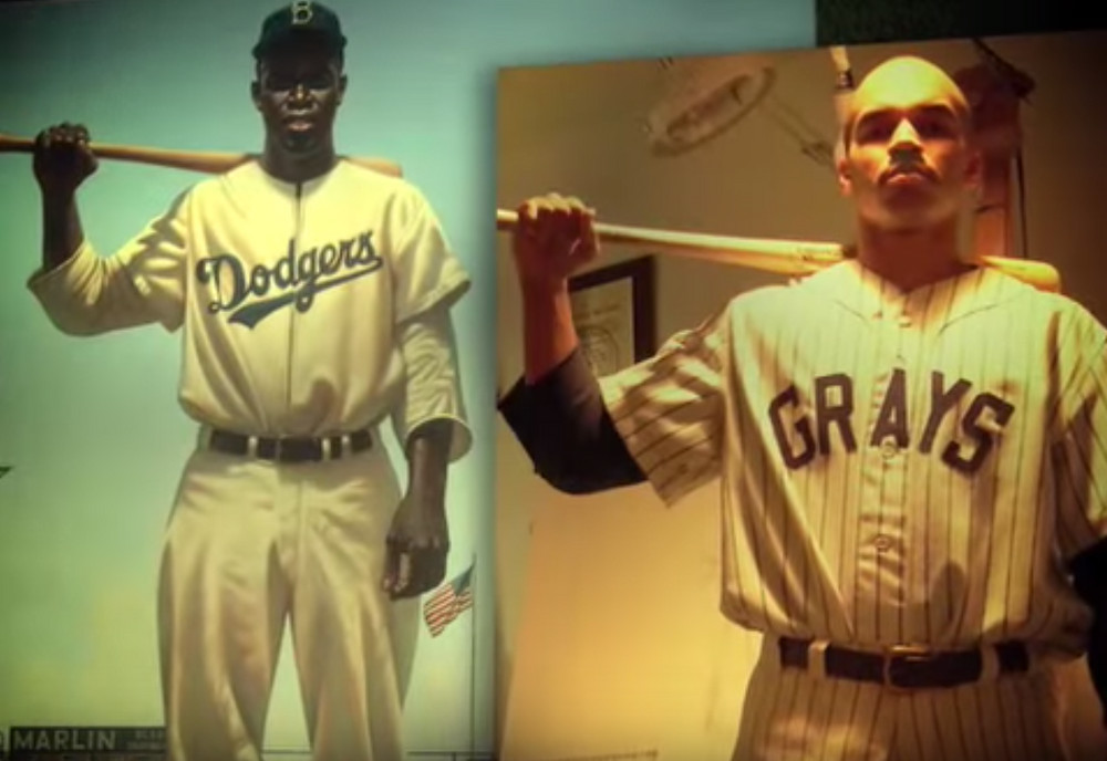 Posing in uniform to then produce a Jackie Robinson image