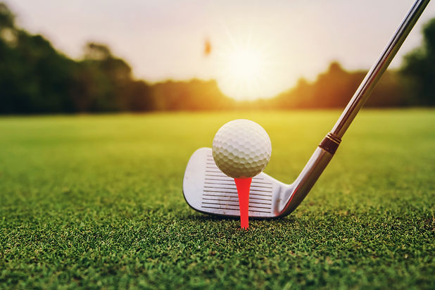Golf Club and Ball on Tee - shutterstock