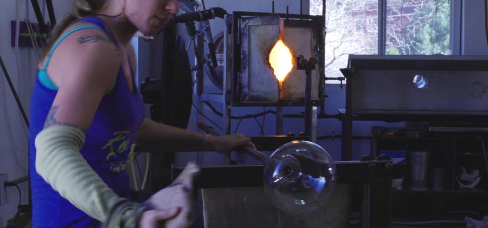 Owner Jessica making pendant lights for Mantra Glass Art