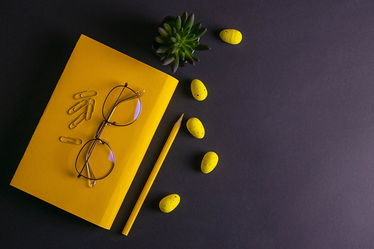 Yellow pencil, yellow notebook glasses,
