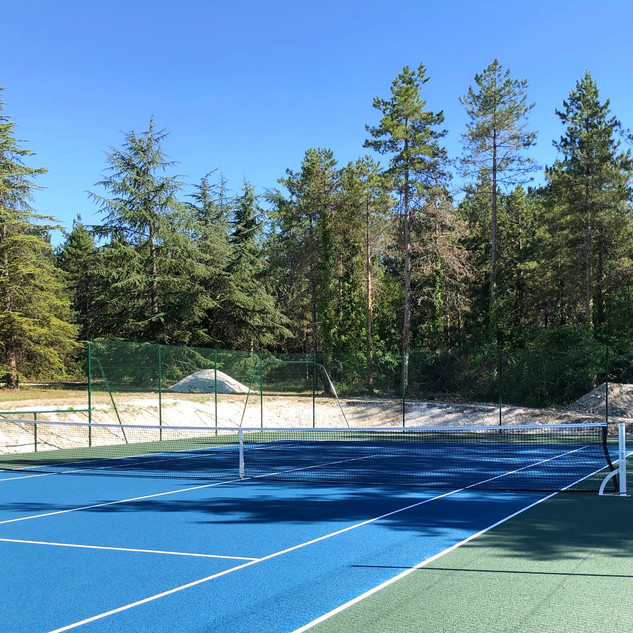 Tennis court forest view