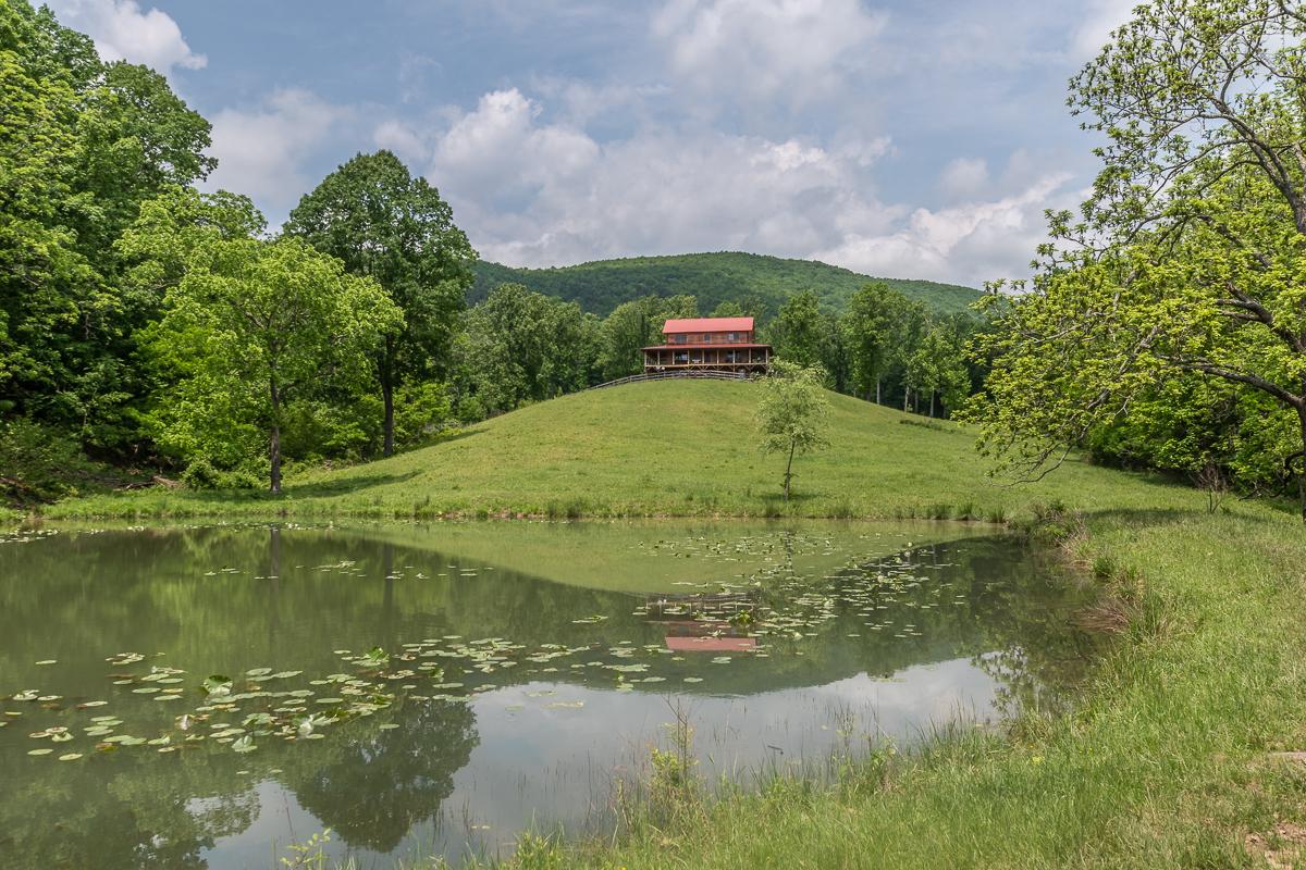 cabin next to pond