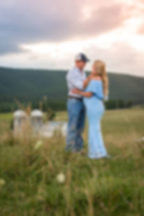 a couple posing on heir farm in Swoope for a maternity session