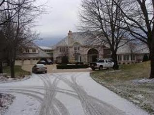 Snow on Concrete Driveway.png
