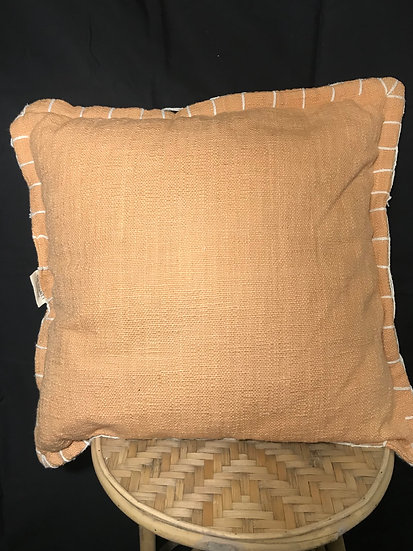 RUST CUSHION WITH STITCHING