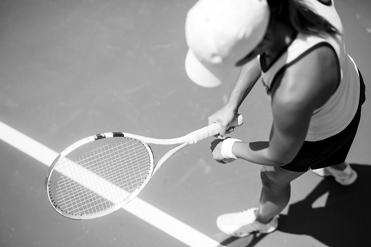 bwBeautiful-female-tennis-player-serving