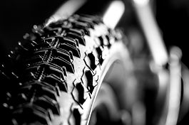 Bicycle wheel and tire close up on tread