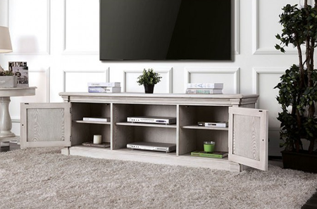 """Two large open shelves allow you to showcase your media devices and give you quick access. The cabinet faces feature a cottage style etching, column styled corners, and antique white finish. Available in 60"""" and 70"""" sizes.  72"""" Tv Stand size: 72""""L X 18""""W X 24""""H 60"""" Tv Stand size: 60""""L X 18""""W X 24""""H"""