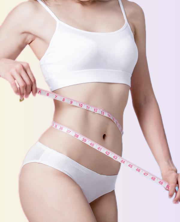 stock-photo-woman-take-waist-scale-tape-