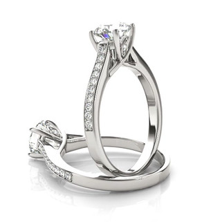 The Savannah is an engagement ring with a diamond set shank, now available from Hogan Fine Jewelry.