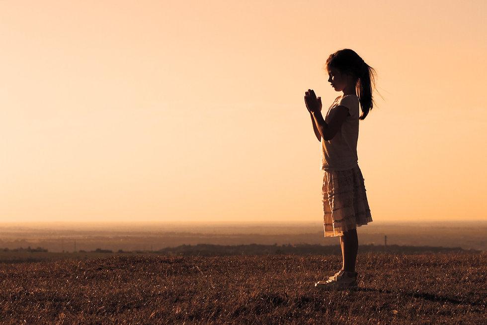 Silhouette of a cute little girl meditating_edited.jpg