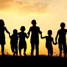 Children running on meadow at sunset.jpg