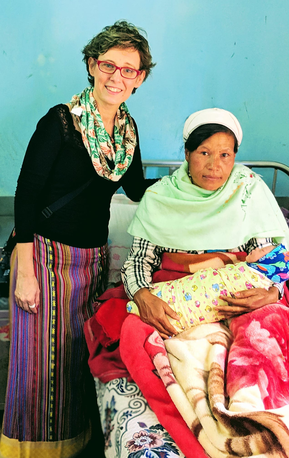 Newborn and her mom at Pindaya, Myanmar