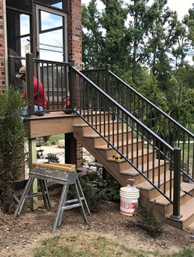 Black handrail on staircase